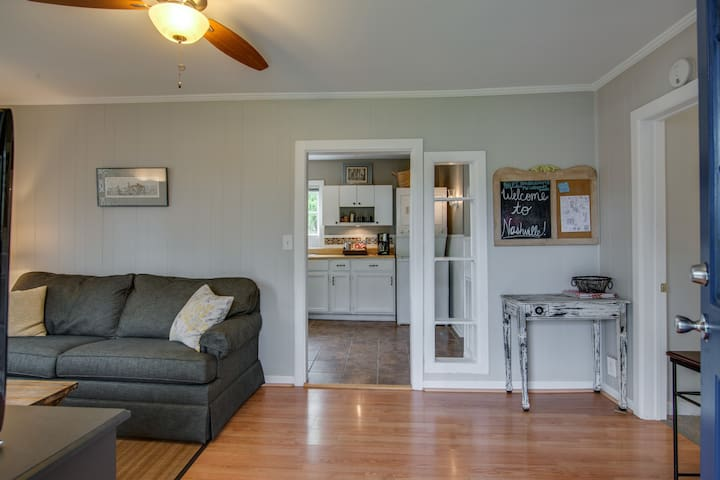The living room features hardwood floors