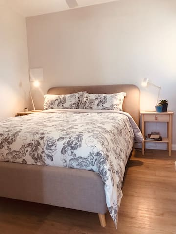 Seperate Bedroom place with wardrobe storage lamps with wireless charging and charging ports.