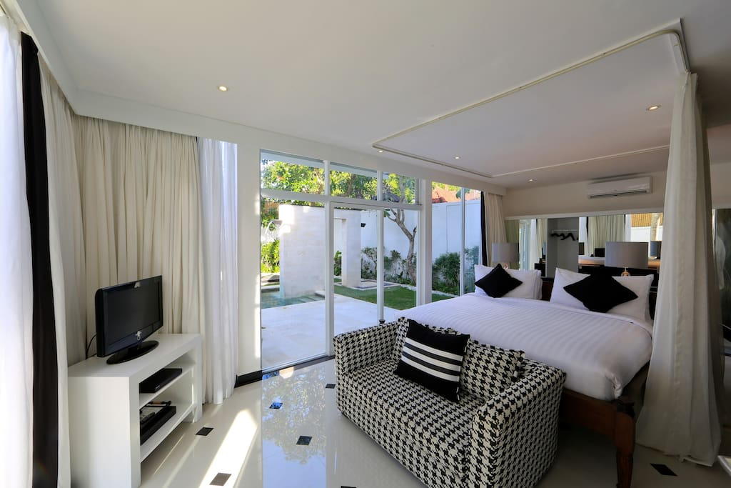 Master bedroom next to garden and the pool