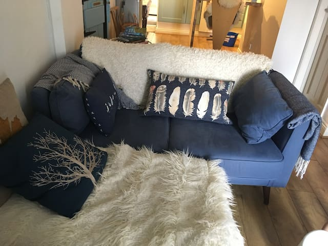 Cozy, comfortable seating area: Sofa Workshop, warm throws and feather filled cushions.