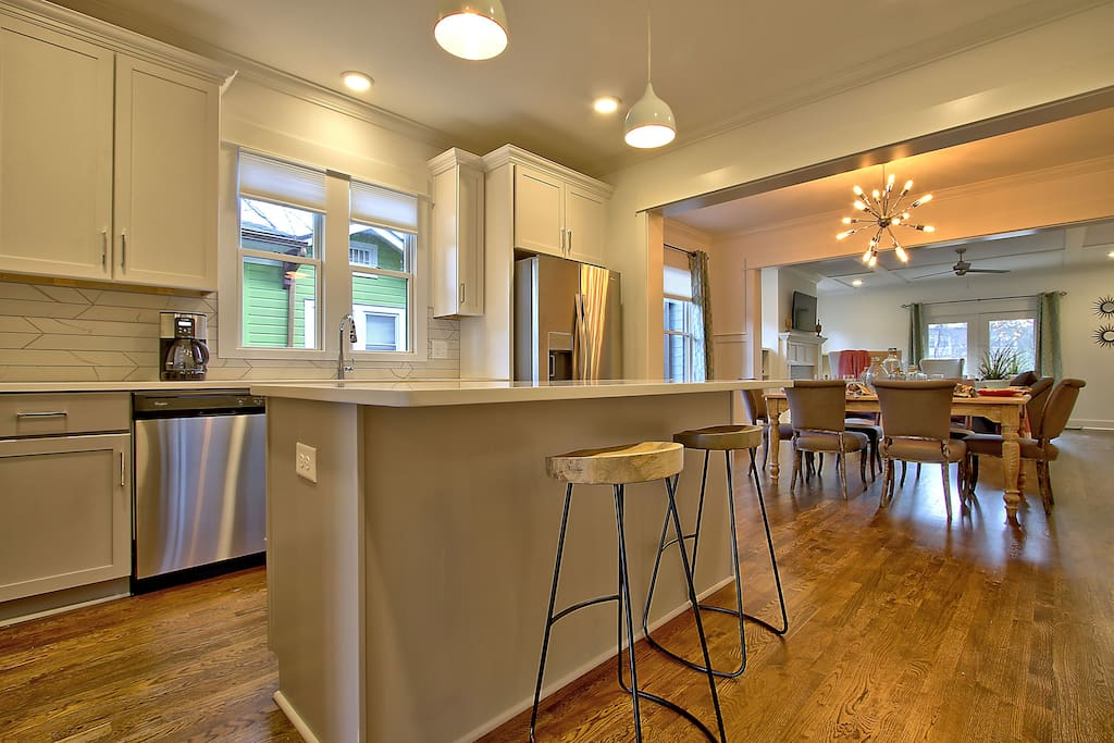Sleek kitchen (one of 2!) with stainless appliances and an eat-in island
