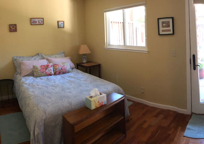 Double bed, window and door to private patio.  No closet but there is a stand to put a suitcase.