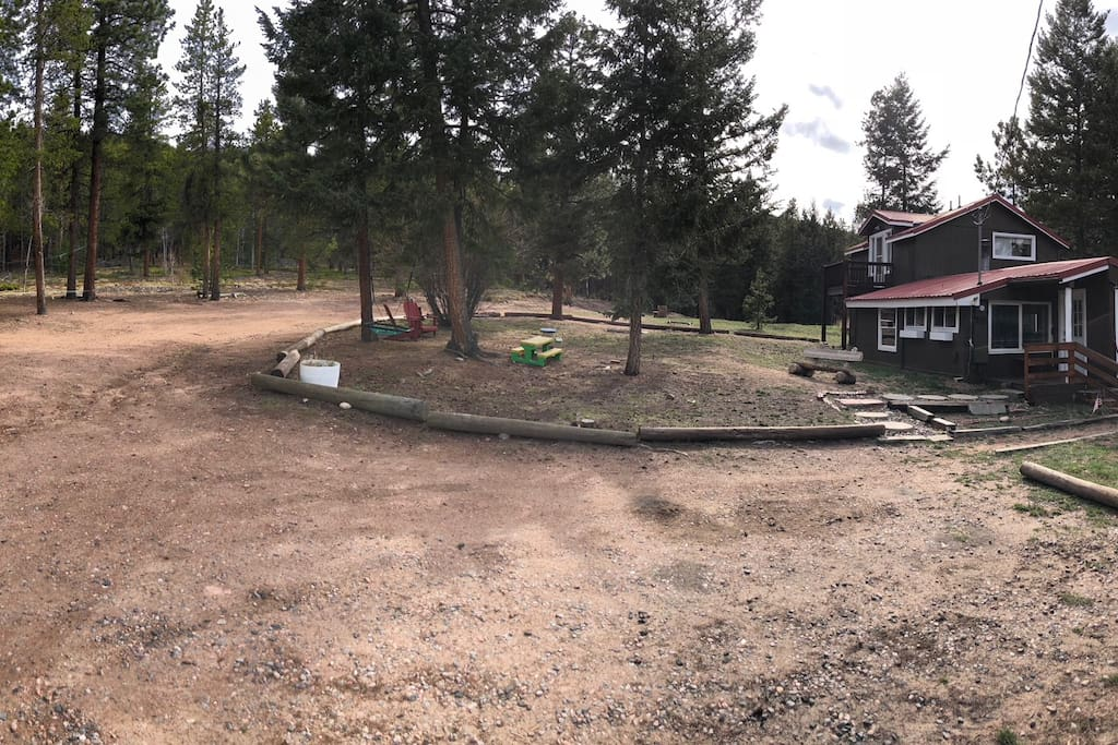 Overview photo of the updated cabin. Parking, swings, slackline, chairs, and lots of area to play.