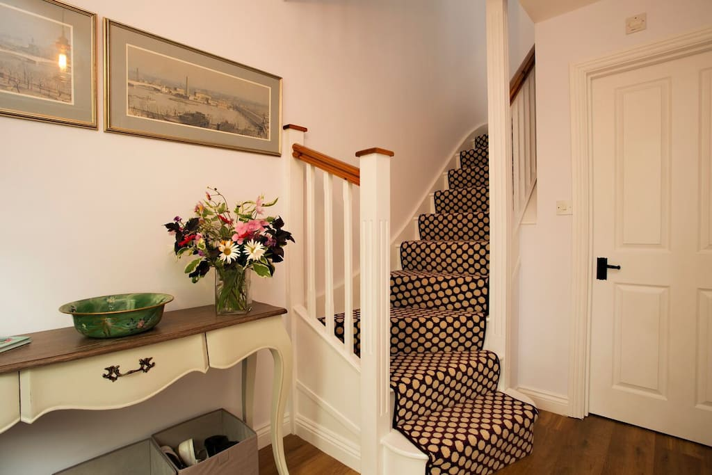 Grand entrance hallway. Fabulous designer carpet, console table, coat hooks, umbrella stand, shoe/boot boxes. Door to large cloakroom with WC & basin, feature designer map wallpaper. Full gas central heating.