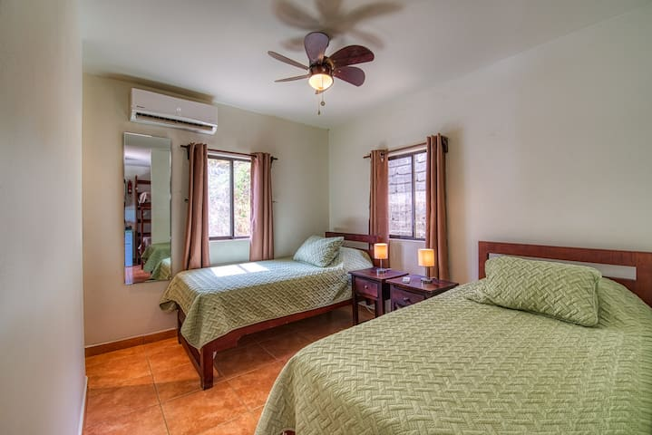 two beds in the bedroom of a casita.