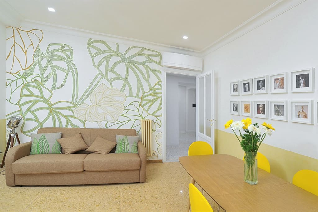 Exceptional natural light in our living room with a spacious table and an eco design wall paper
