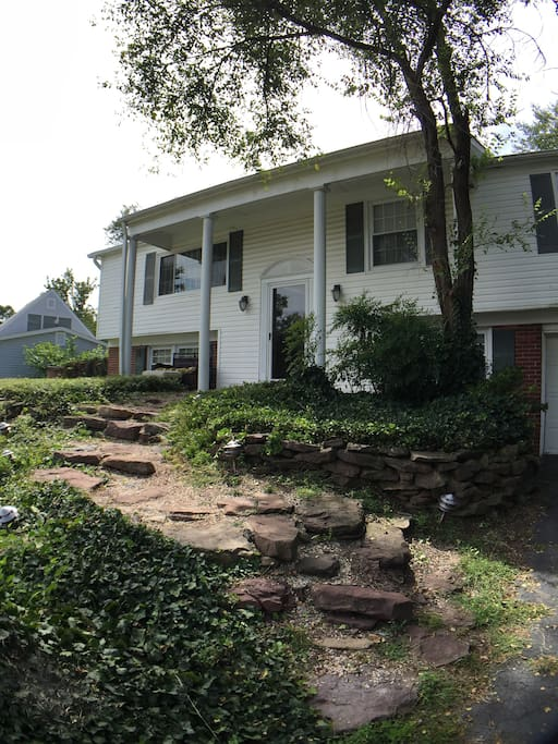 The front of our home with stone walkway.