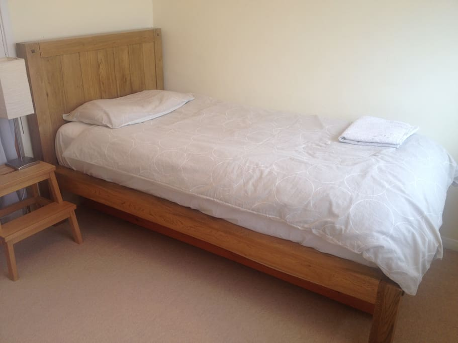 Super comfortable single bed (the second bed is folded underneath)