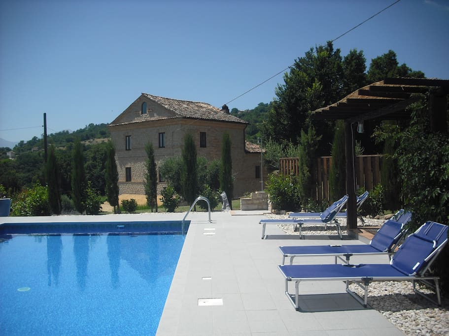 Elevated pool with stunning views across the Siblini mountains and Le Marche countryside.