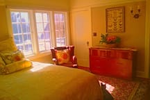 The Hampton Room has a queen-sized bed and is filled with natural light.