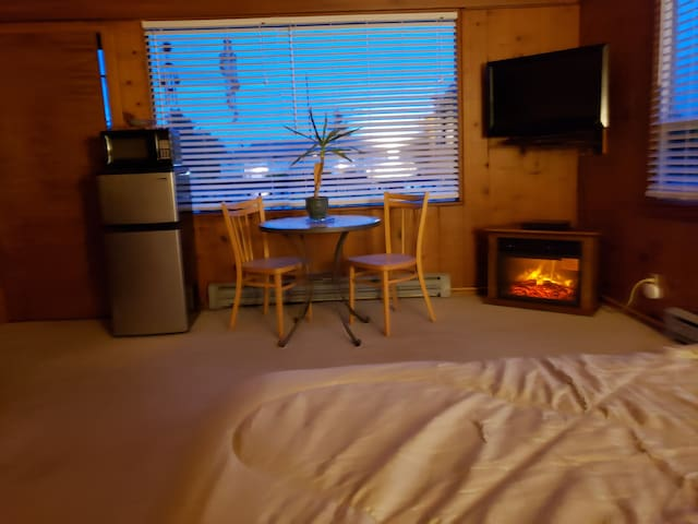 Enjoy the warmth & glow from our cozy fireplace after a trip to the beach.