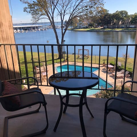 Table on balcony - view of pool & lake