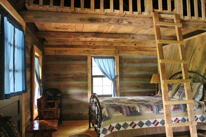 Lakeside Log Cabin queen bed with loft