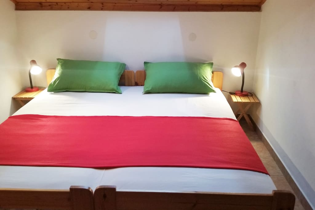 Bedroom with comfortable double bed.