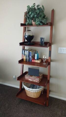 bookcase with card games in the paper box