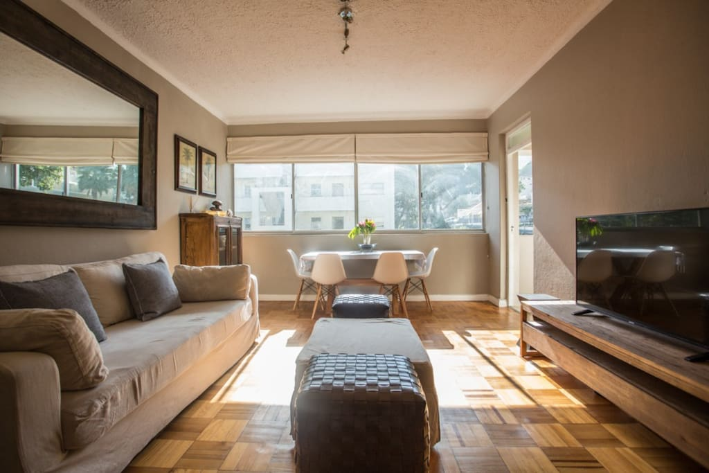 Nice light streaming into the living and dining room leading out to the open balcony.