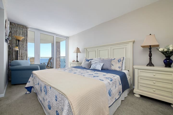 Master/King bedroom with large balcony and ocean views.