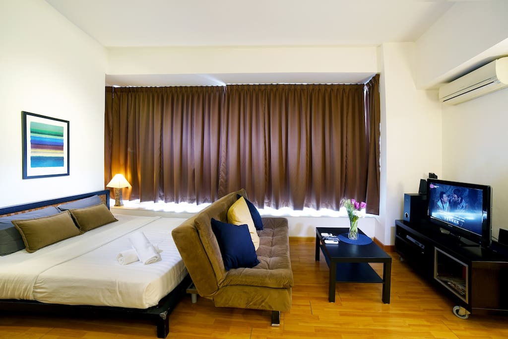 Modern Interior Design Suites Room with Queen size bed with quality linens and towels.