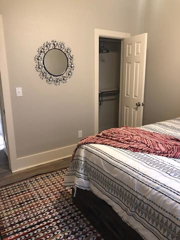 This is the first bedroom. This bedroom has a queen bed with wonderful closet and beautiful decor.