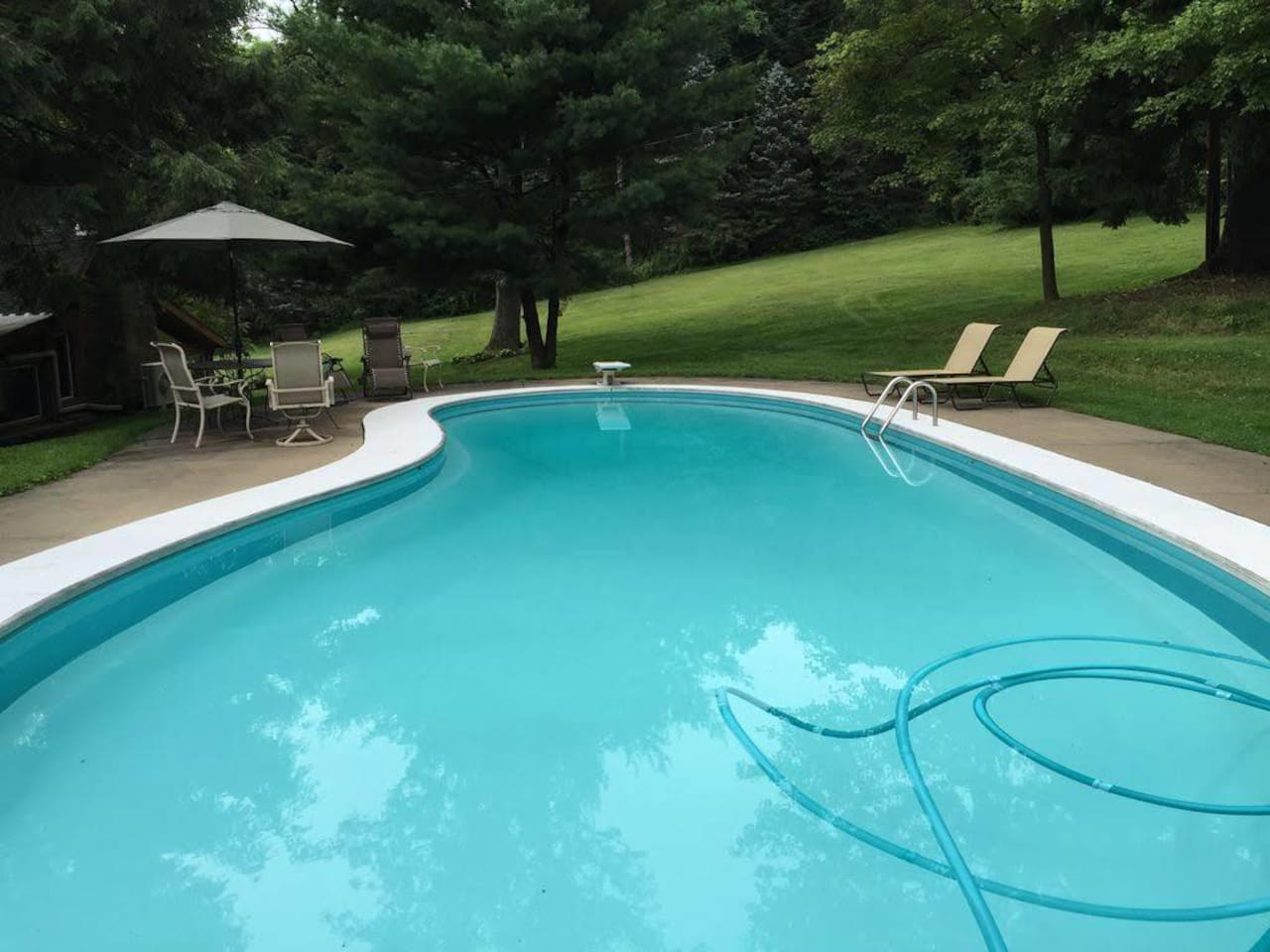 12ft deep with diving board, open from May 1st-October 1st