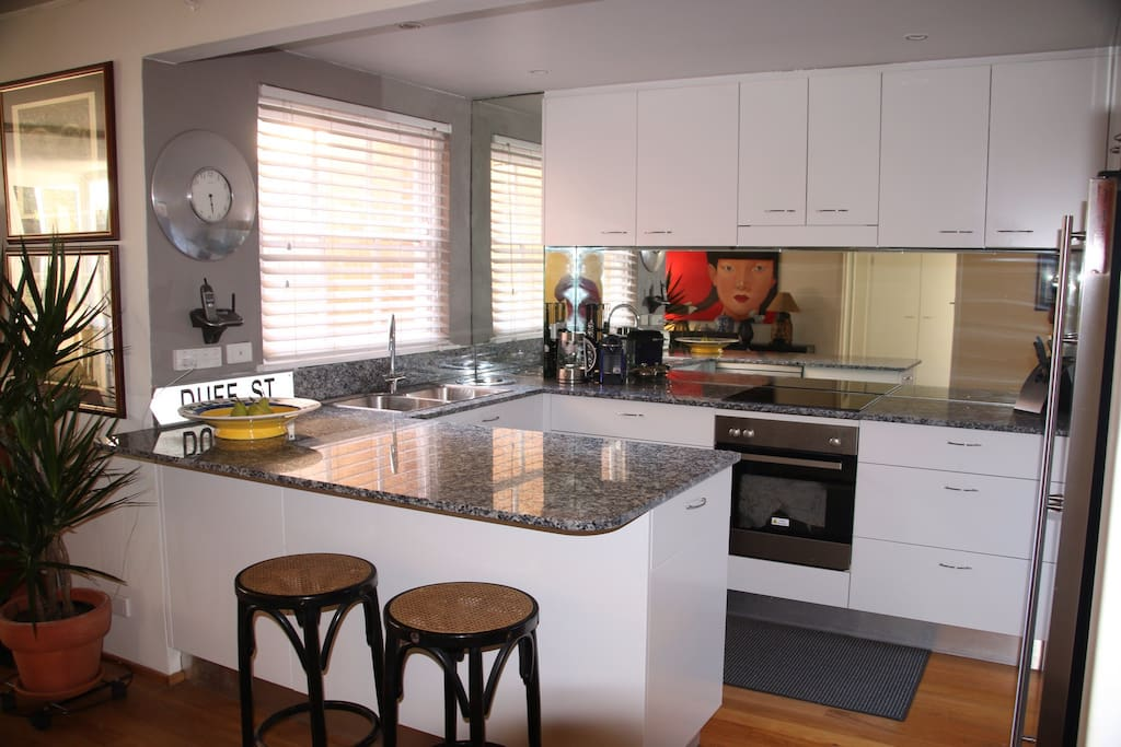 Kitchen with stainless appliances and granite bench tops.