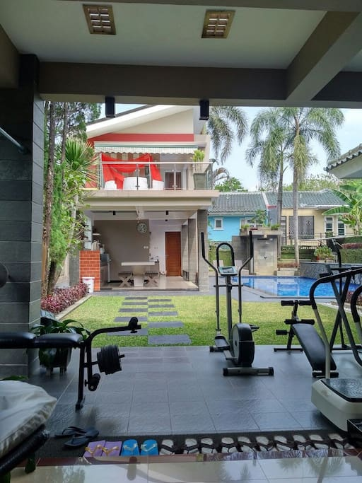 sitting area .pantry and open air terrace of 101 pool house. (some gym equipment)