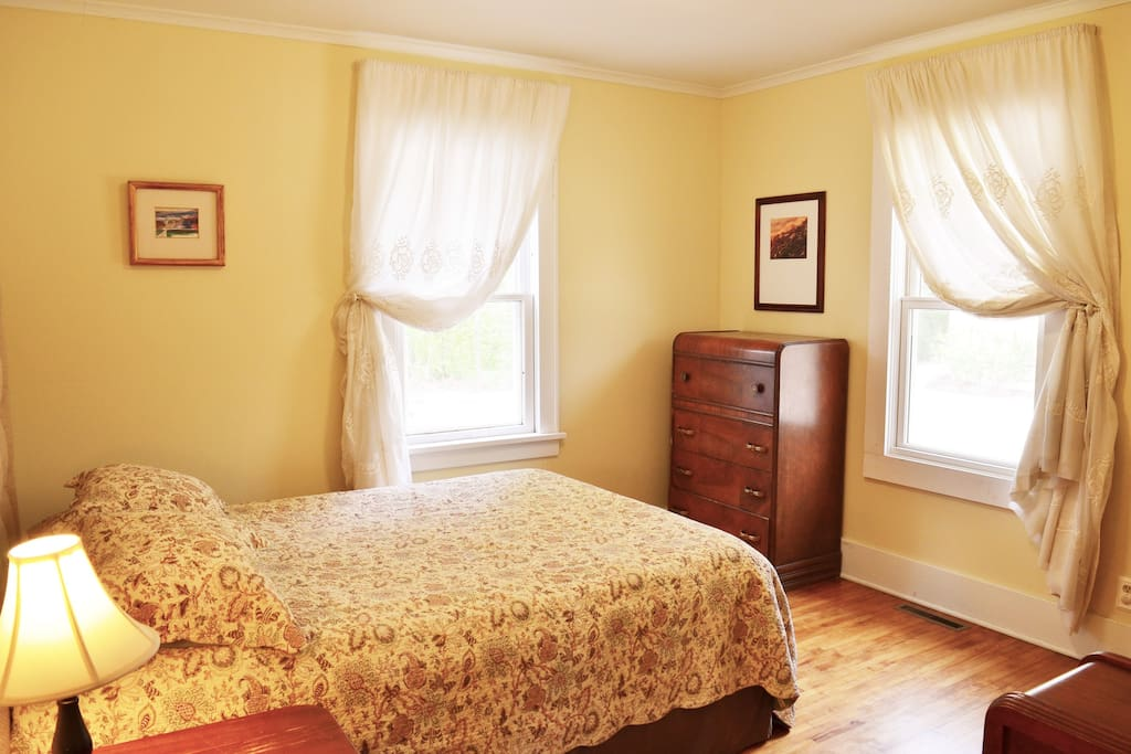 Largest bedroom with queen bed view #2
