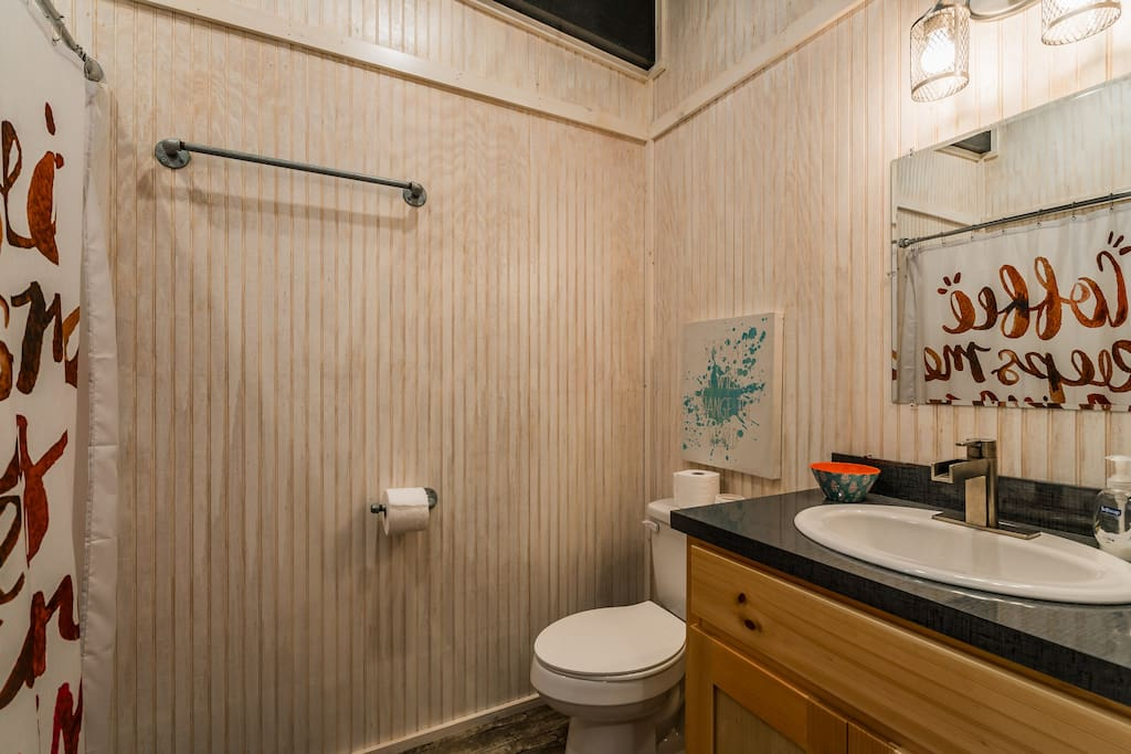 Bathroom with shower, washer+dryer, iron+ironing board, bath linens provided
