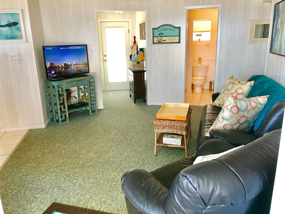 Widescreen & DVD with couch and recliner in Living area
