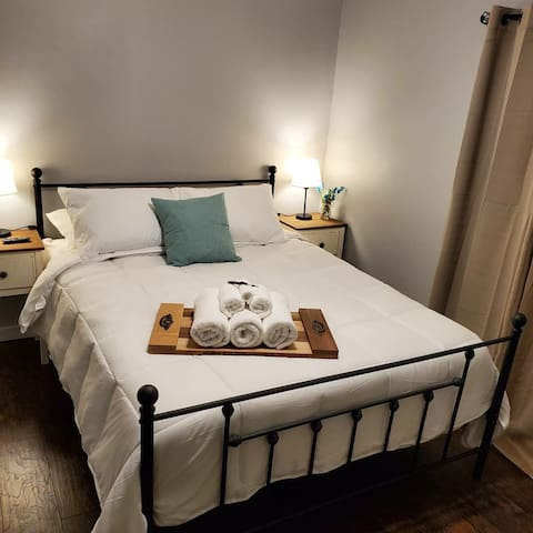 Our beds have a large fluffy comforter, an extra blanket, both medium and extra firm pillows!  Both bedrooms have a closet with a shelf and a custom luggage rack to avoid stains on the bed from the guest luggage.