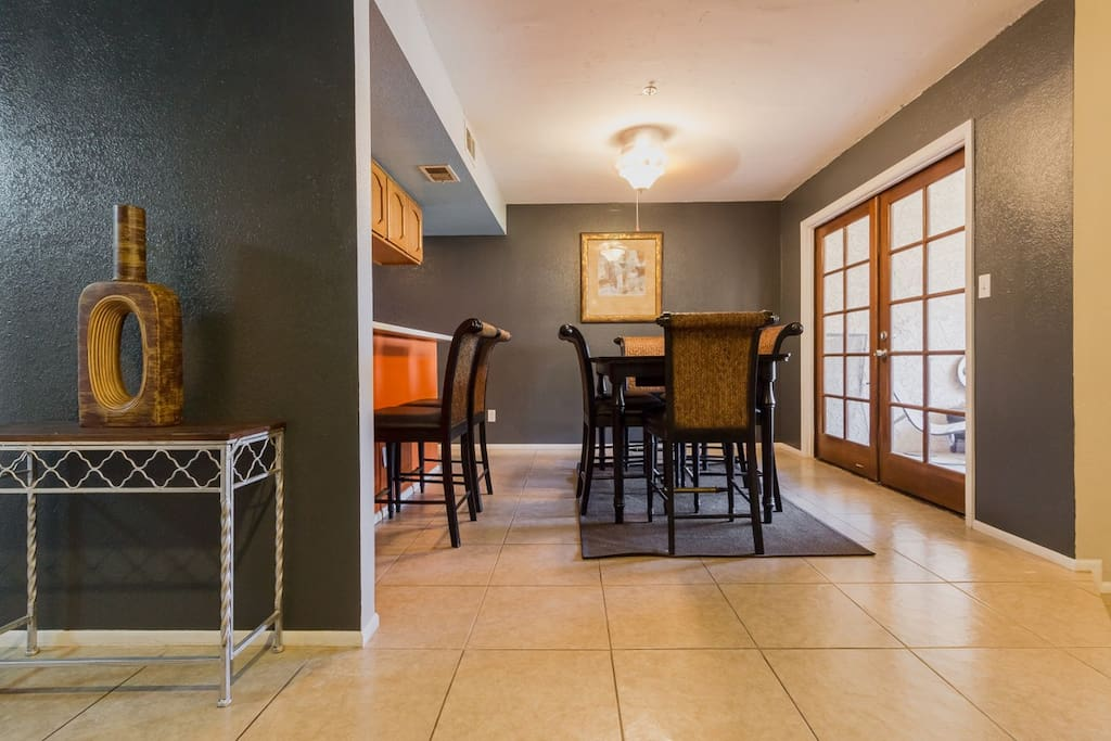 Enter into the sunny open floor plan with vaulted ceilings.