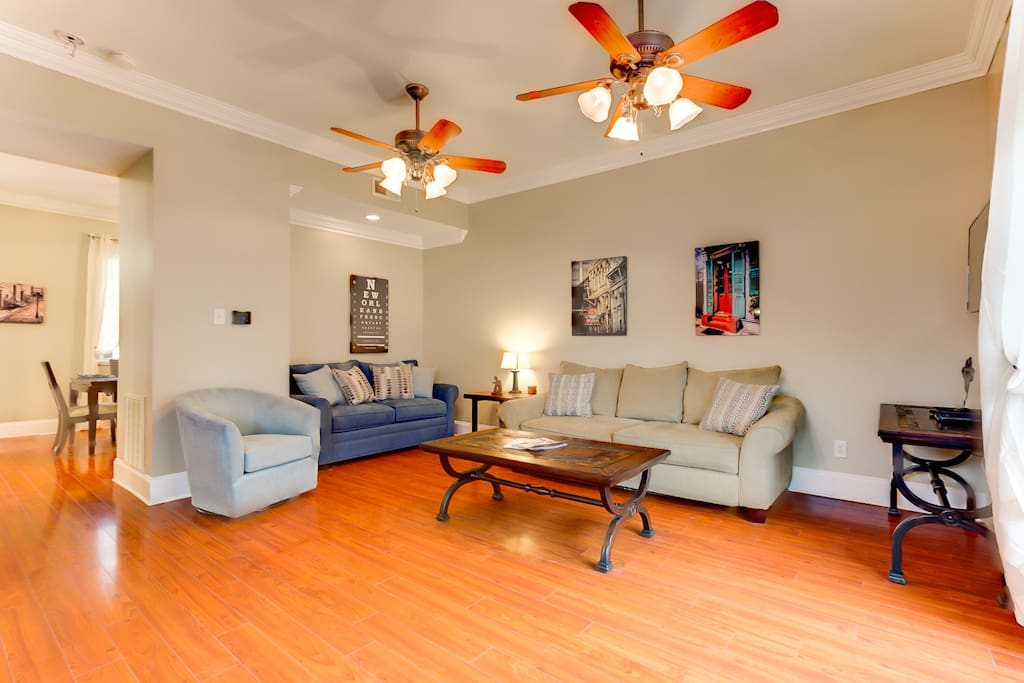 Spacious living room with ample comfortable seating.
