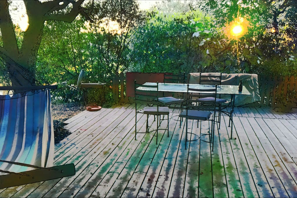 Autum sunset on the wooden terrasse overlooking olive grove