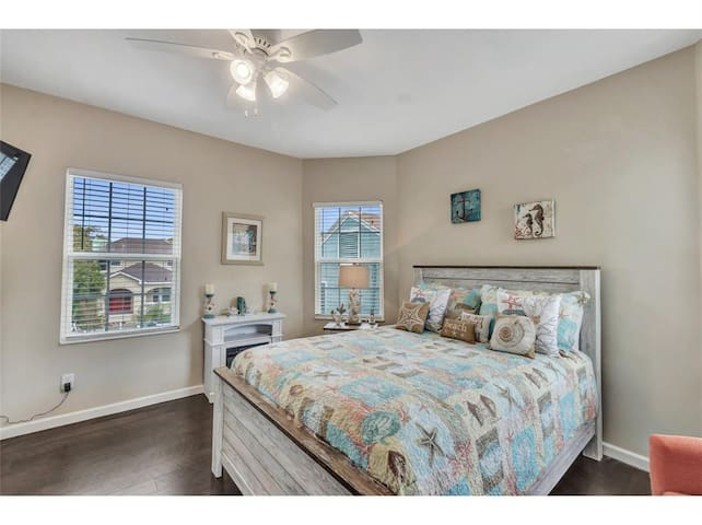 Second floor bedroom with plush queen bed and Smart TV.