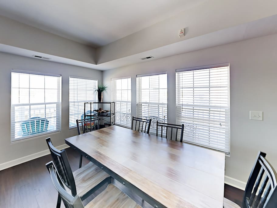 Enjoy views through wall-to-wall windows as you dine at the 6-person table.