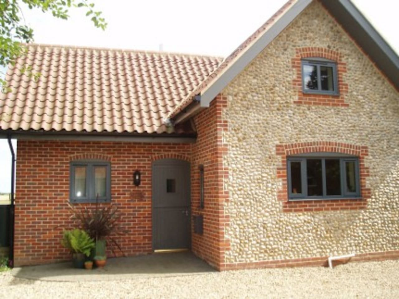Traditional Norfolk style on the outside, but the inside modern and light filled, with underfloor central heating downstairs