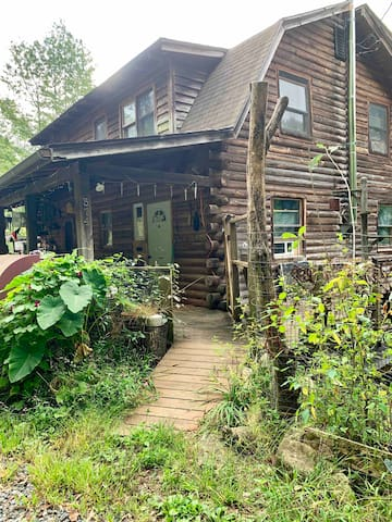 My log cabin. The white door in this photo is the access to your bathroom and shower anytime day or night