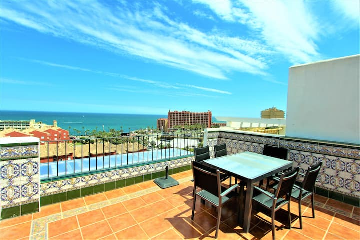 Home working in this penthouse with sea views. 21