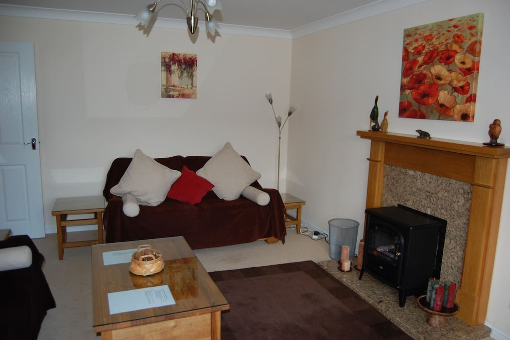 Cosy lounge facing on to front garden.  Satellite tv, dvd and cd players.  Wifi throughout house.