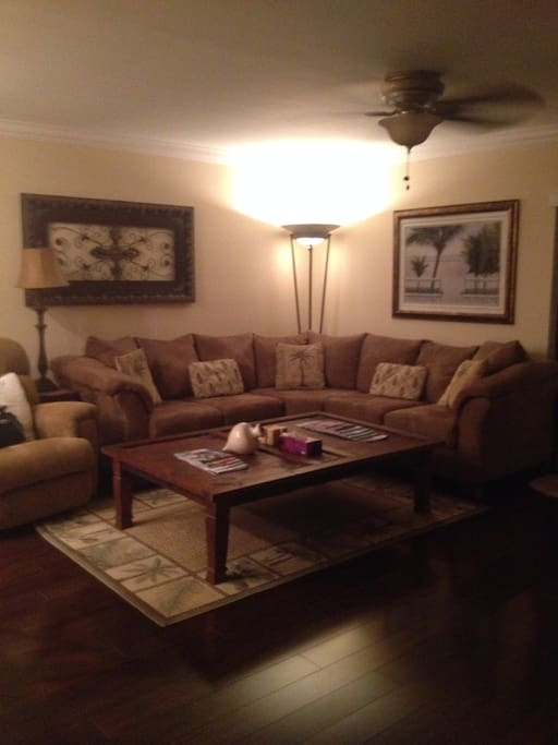 Large living room with sectional and rocker