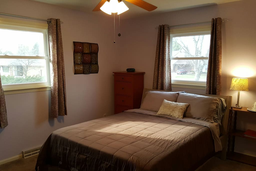 This large and comfortable private room has a queen mattress with 3 inch foam topper, two windows overlooking the back and side yard and an attached private bathroom!