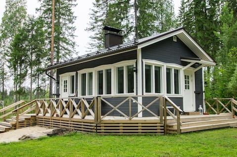Sauna cabin on the shore of a small river
