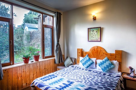 Snow capped peaks from comfort of your bed|Cottage