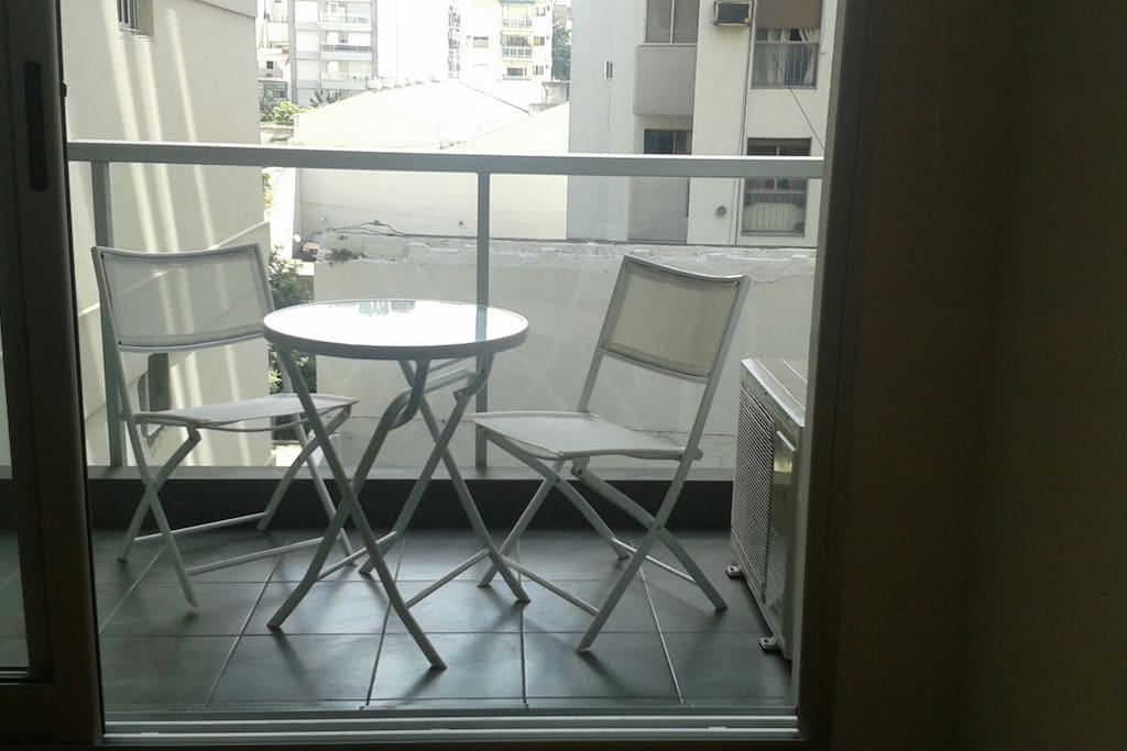 Balcony with small table and two chairs