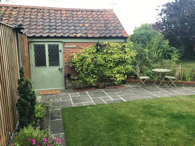 Self contained annexe with outside table and chairs.