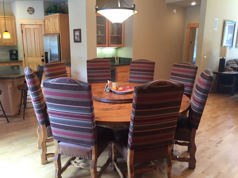 Dining with kitchen to left and family room to right