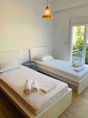 Our second Bedroom with two single beds, a big wardrobe and a nightstand!