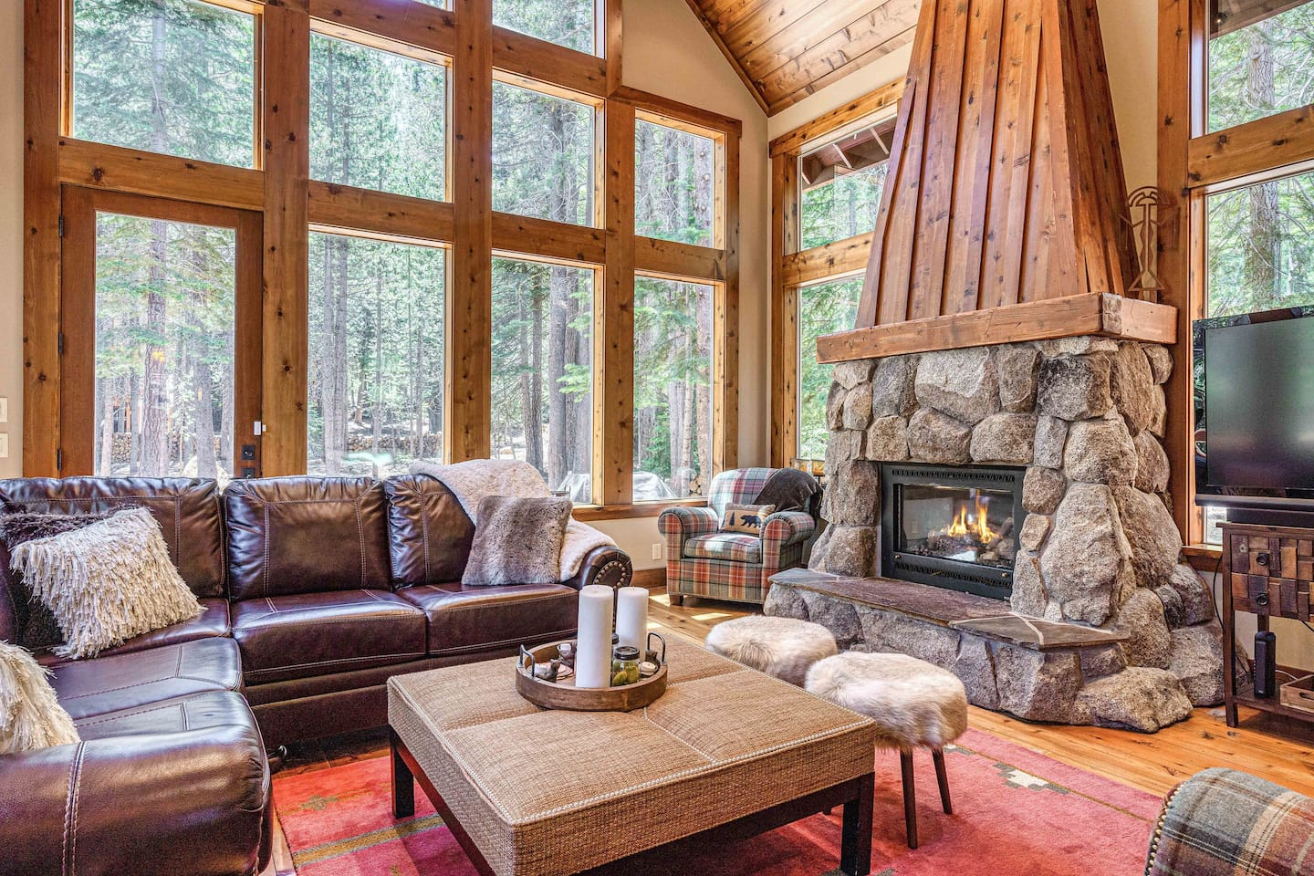 Welcome to Truckee! This Tahoe Donner dream is professionally managed by TurnKey Vacation Rentals. Cozy up around the gas fireplace with stone surround in the main living area.