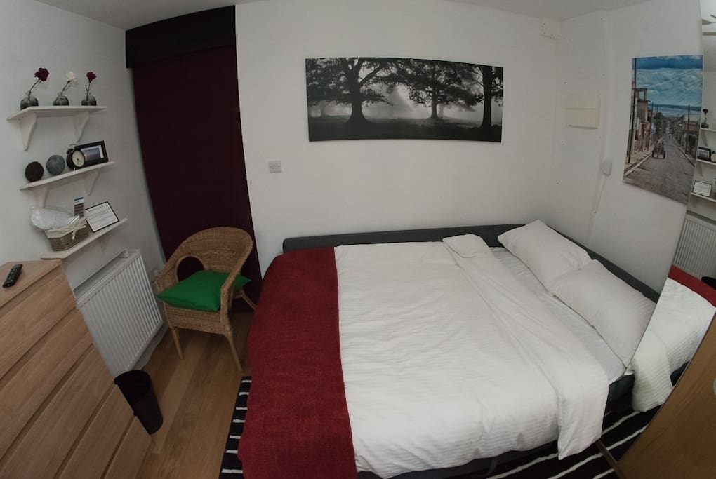 """Space made up as Sleeping area: radiator, pullout double bed, chest of draws (stocked with extra set of bed linen), 24"""" Freeview TV, mirrored wardrobe (with safe deposit box)"""