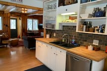 Open kitchen which is fully stocked with cooking equipment and utensils.